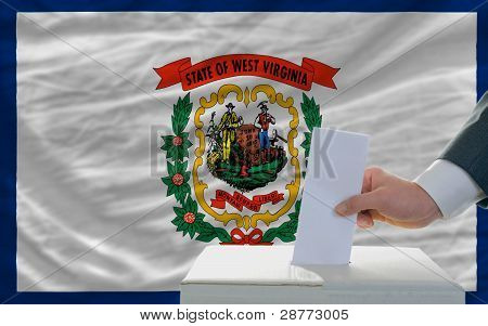 Man Voting On Elections In Front Of Flag Us State Flag Of West Virginia