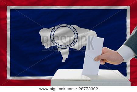 Man Voting On Elections In Front Of Flag Us State Flag Of Wyoming