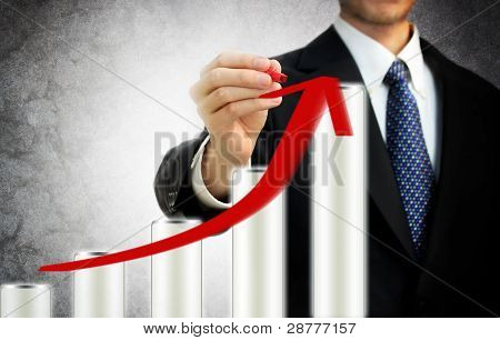Businessman Drawing A Rising Arrow Representing Growth
