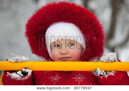 Little Girl In A Red Jumpsuit