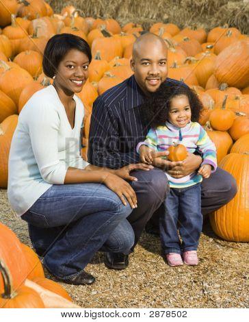 Family Picking Pumpkin.
