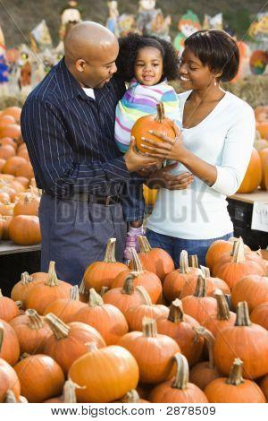 Family Buying Pumpkin.