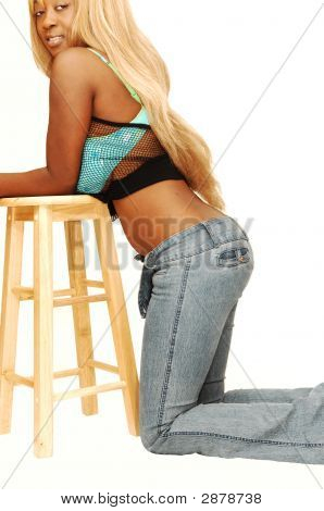 Young Jamaican Girl Kneeling