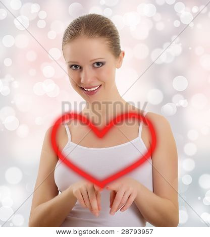 Beautiful Young Woman Draws A Big Red Heart