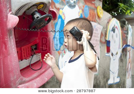Happy kids listening to the phone toys