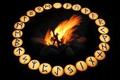 foto of thor  - runes set around fire in classical alphabetical order futhark - JPG