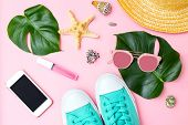 Summertime And Travel Feminine  Accessories On Pink Background. Flat Lay poster