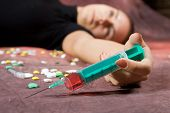stock photo of drug addict  - Drug addict with syringe - JPG