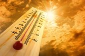 stock photo of hot-weather  - thermometer in the sky - JPG