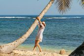 Traveler Girl Enjoying On Tropical Beach. Young Girl Traveler Relaxing In Vacation. Traveler Relaxin poster