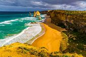 Magic light on the Pacific coast near Melbourne. The Great Ocean Road. Rocks Twelve Apostles in ocea poster
