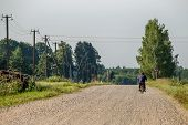 Summer Landscape With Road, Trees And Blue Sky. Man Ride To The Moped On Countryside Road. Rural Roa poster