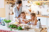 Family Are Cooking Italian Pizza Together In Cozy Home Kitchen. Cute Kids With Happy Mother Are Prep poster