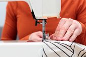 Processes Of Sewing Flax On The Sewing Machine Sew Womens Hands Sewing Machine Linum. Sewing Machin poster