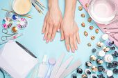 Manicure - Tools For Creating, Gel Polishes, All For Nail Care, Beauty And Care Concept. On A Blue B poster
