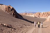 foto of street-walker  - peoples walk in Atacama desert Chile  - JPG