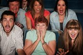 pic of bleachers  - Shocked group of 7 people in theater - JPG