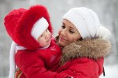 pic of ruddy-faced  - Young mother with her baby daughter in the winter - JPG