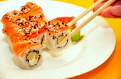 Colorful Sushi On White Plate. Red Sushi Roll With Rice Salmon Fish Sesame Black & White Seeds Wasab poster