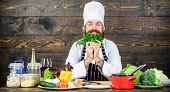 Man Bearded Hipster Cooking Fresh Vegetables. Culinary Recipe Concept. Freshest Possible Ingredients poster
