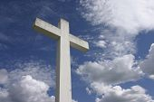 stock photo of christian cross  - Huge Christianity cross and natural sky background - JPG