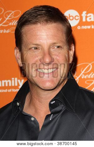 "LOS ANGELES - OCT 16:  Doug Savant arrives at  ""Pretty Little Liars"" Special Halloween Episode Screening at Hollywood Forever Cemetery on October 16, 2012 in Los Angeles, CA"