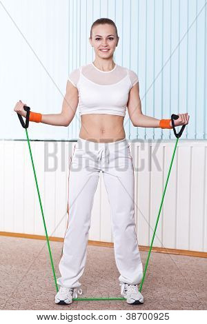 Fitness Woman Doing Exercise With Expander
