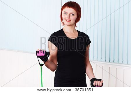 Redhead Fitness Woman Doing Exercise With Expander