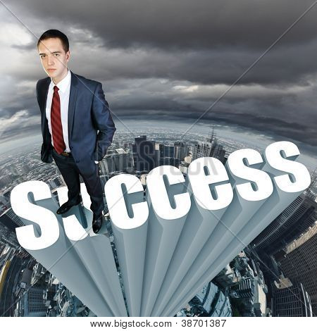 Businessman in suit standing on the word Success