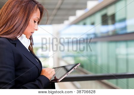 Business woman working with a digital tablet at modern office