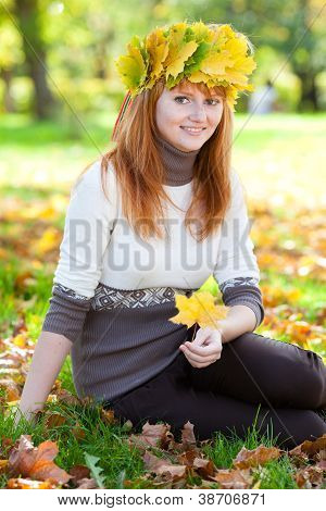 Portrait Of A Beautiful Young Redhead Teenager Woman In A Wreath Of Maple Leaves