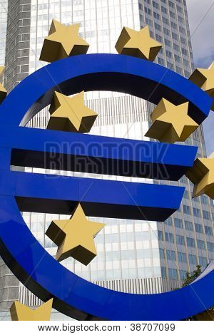 FRANKFURT, GERMANY - AUG 22: The Famous Big Euro Sign at the European Central Bank on August 22, 2012 in Frankfurt, Germany. The bank was established by the Treaty of Amsterdam in 1998.