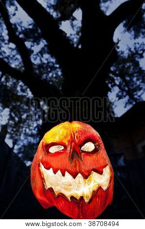 Evil Pumpkin - Jack O Lantern with Dark Tree and Houses