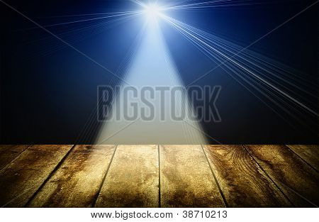lighting over dark background and wood floor