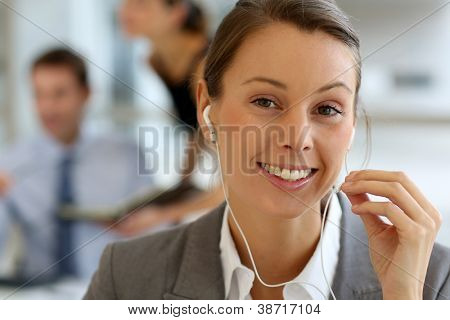 Businesswoman talking on mobile phone with handsfree device
