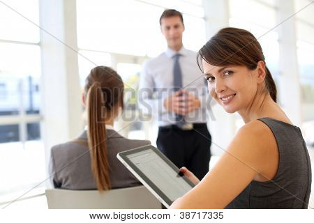 Businesswoman attending business presentation