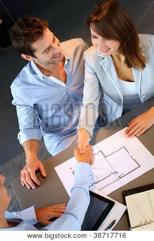 Couple concluding construction and financial contract