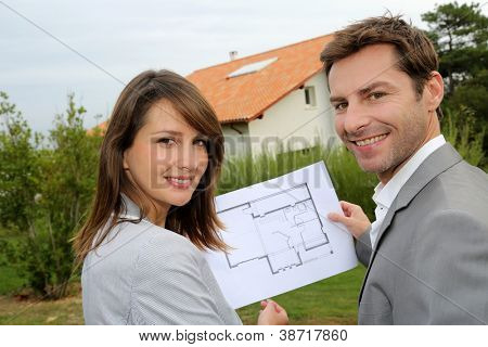 Couple looking at their new built house