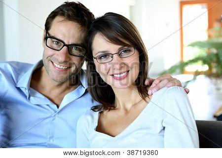 Smiling couple wearing eyeglasses