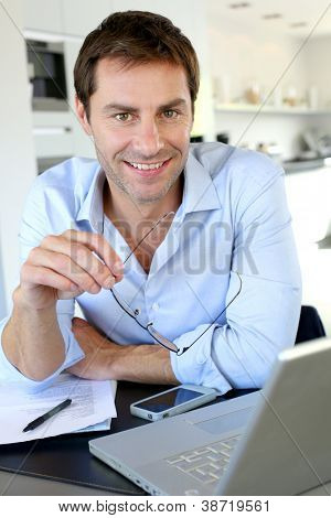 Portrait of businessman working from home