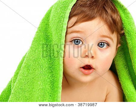 Image of cute baby boy covered with green towel isolated on white background, closeup portrait of cheerful kid with blue eyes, health care, pretty infant after bath, happy childhood, child's hygiene