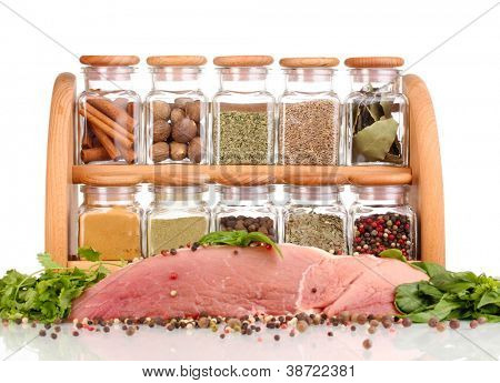 A large piece of pork marinated with herbs and spices isolated on white