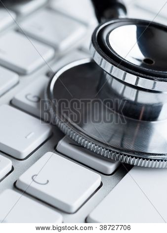 Close up of stethoscope on computer keyboard. Medicine concept