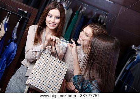 Pretty women pay with credit card and take away purchases