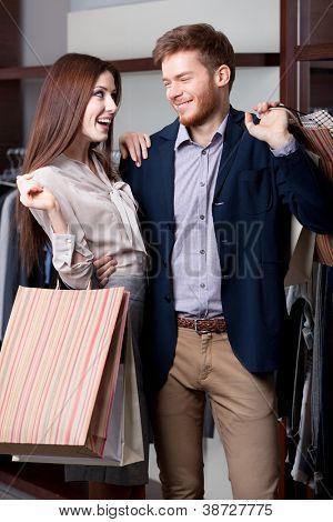 Smiley couple likes shopping