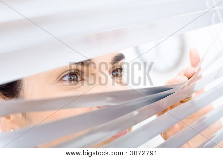 Woman Peeping Though Window