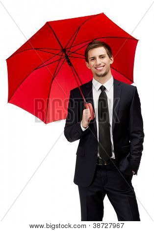 Businessman holding opened red umbrella overhead, isolated on white