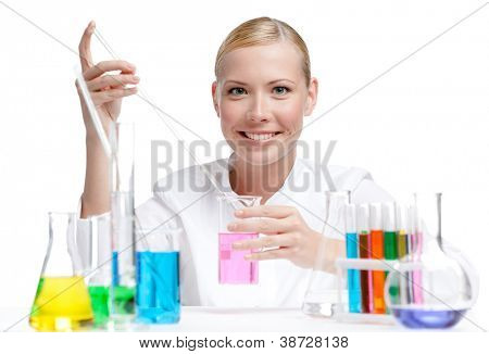 Female doctor surrounded by medical vials and flasks makes some researches, isolated on white
