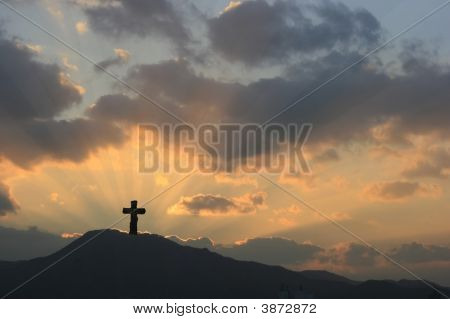 Cross On Dramatic Sunset