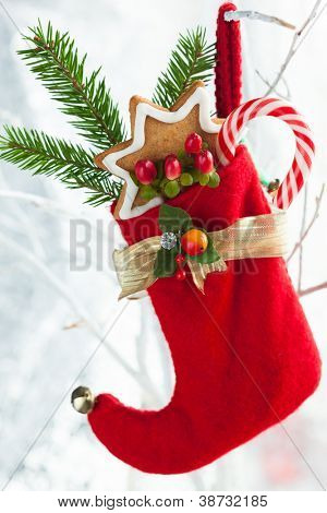 Christmas stocking with gifts,sweets and cookies